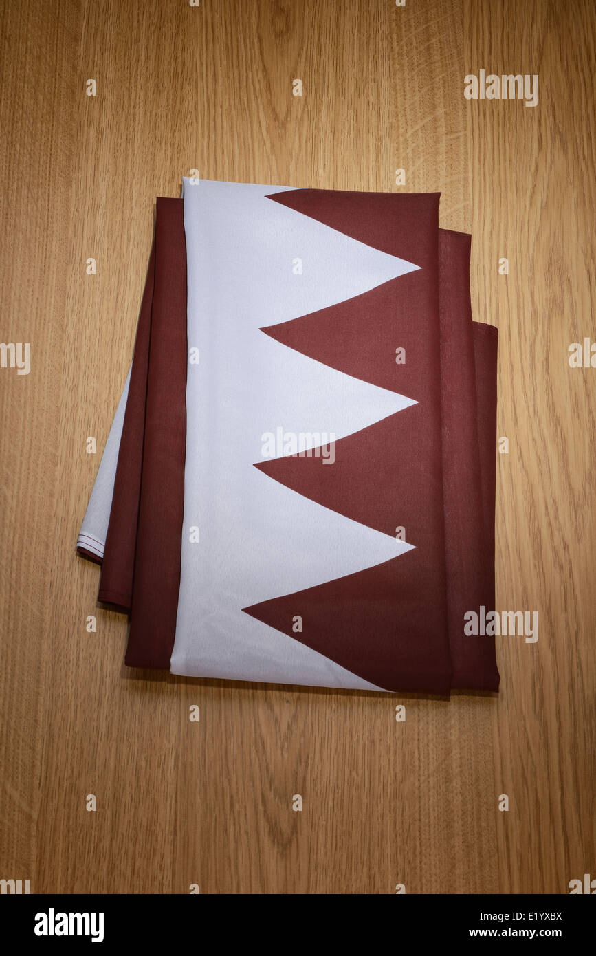 Folded Qatar flag - Stock Image