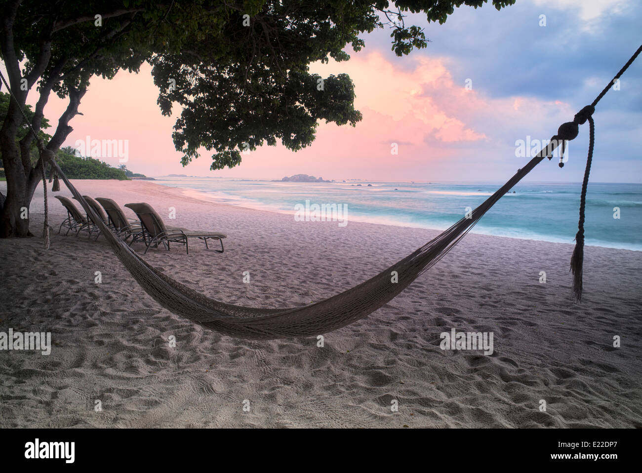 Sunset on beach with hammock at Punta Mita, Mexico. - Stock Image