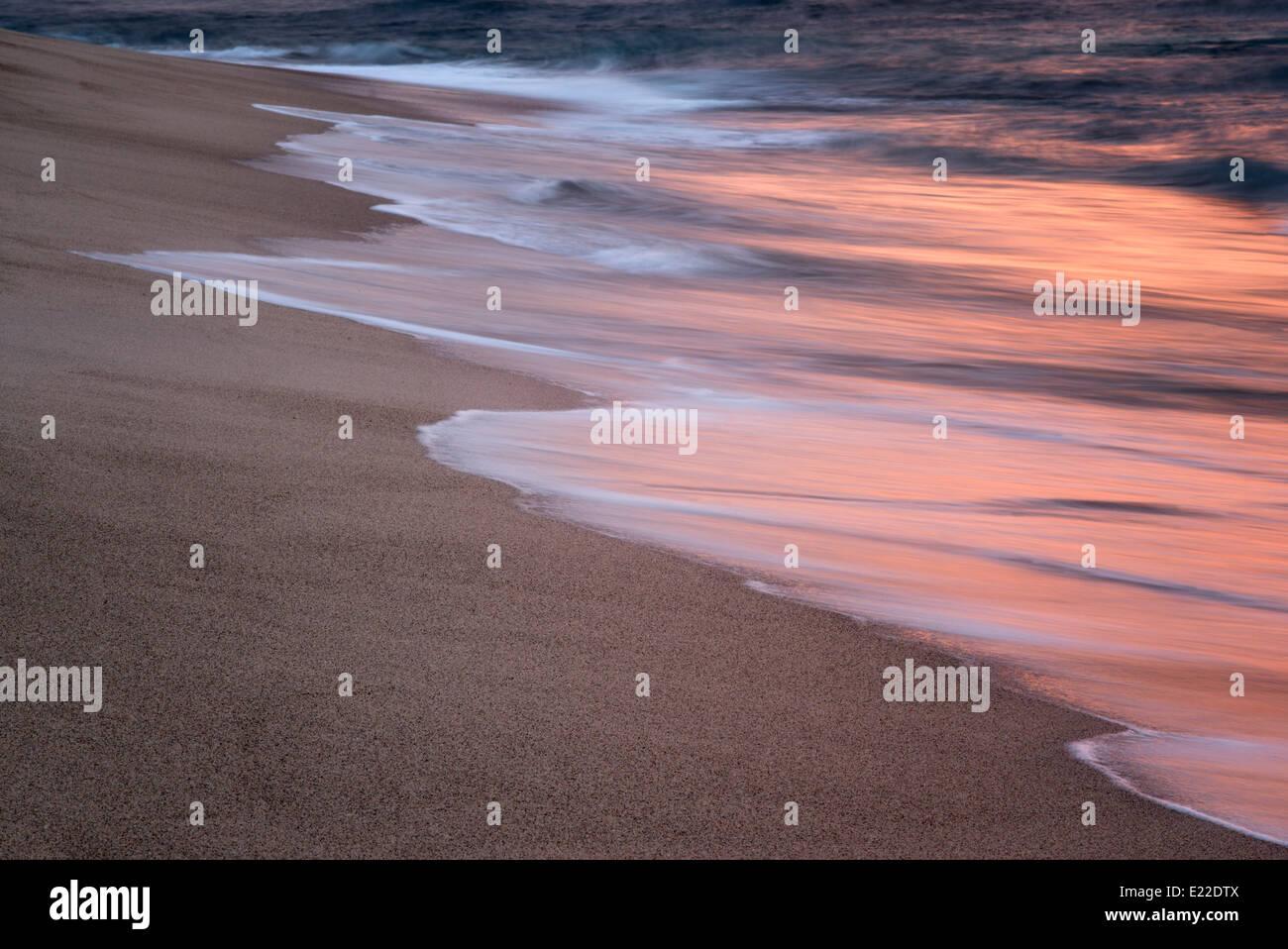 Ocean wave reflecting sunset. Punta Mita, Mexico - Stock Image