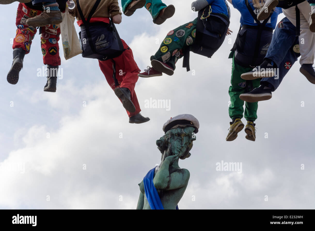 Students dangling over Havis Amanda Statue on May Day Eve celebration in Helsinki Finland 2014 Stock Photo