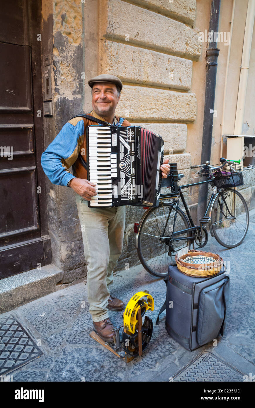 Accordion player in the street, Syracuse, Sicily, South Italy Stock Photo