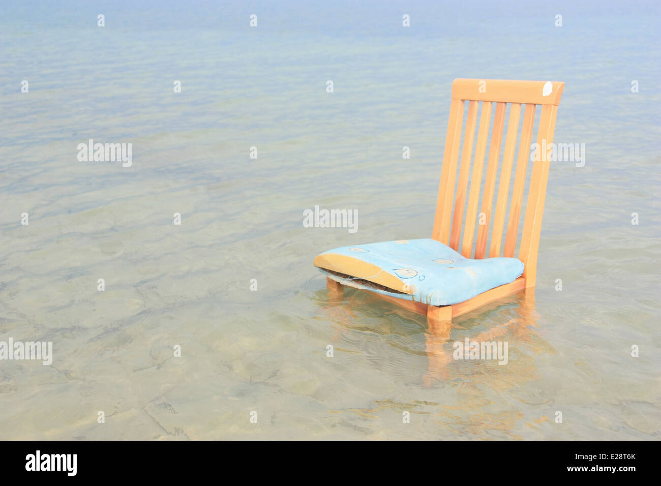 Chair in the sea - Stock Image