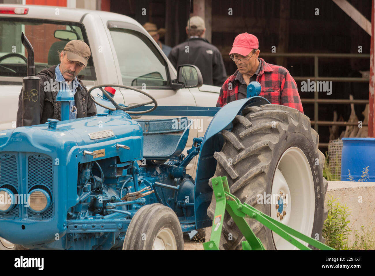 two-farmers-inspect-a-fordson-dexta-tractor-at-a-local-country-auction-E29HXF.jpg