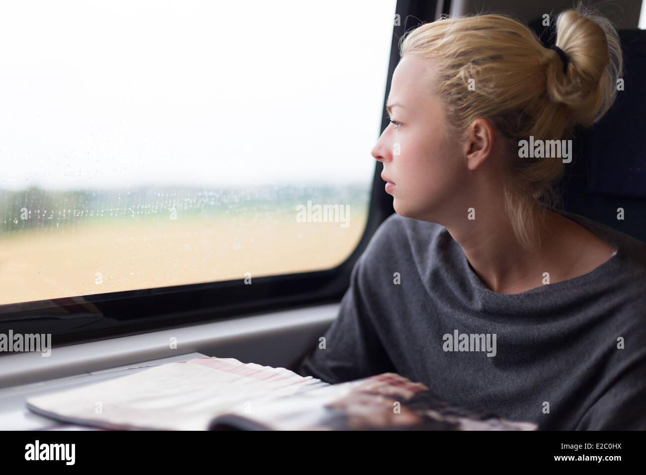 Lady traveling by train. - Stock Image