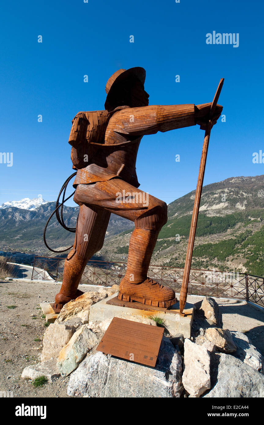France, Hautes Alpes, Briancon, metaphor of the alpine conquest, the mountaineer Edward Whymper looking at the Barre - Stock Image