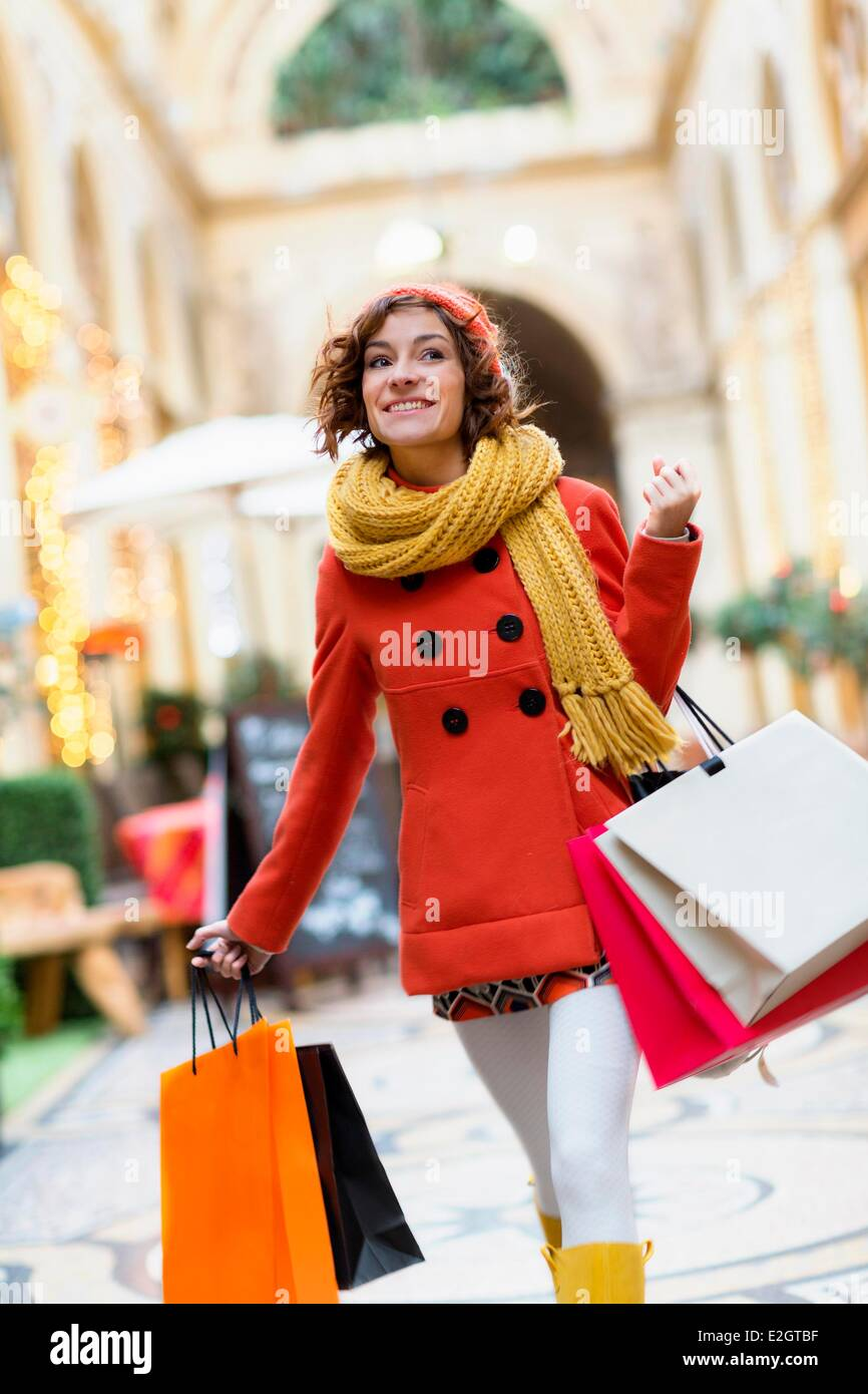 France Paris Woman shopping in Galerie Vivienne - Stock Image
