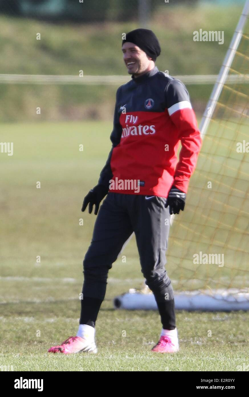 David Beckham appears in good spirits as he trains in pink Adidas football  boots and a Paris Saint-Germain kit Featuring  David Beckham Where  London 9f7040f45112