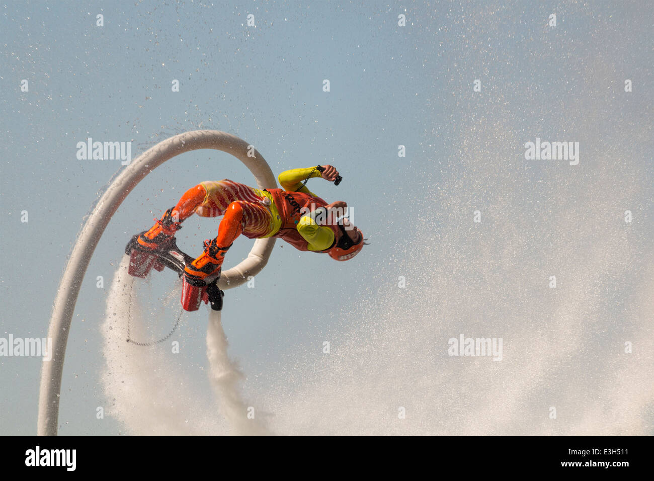Male flyboarder doing a backflip at the North American Flyboard Championships in Toronto, Ontario, Canada Stock Photo