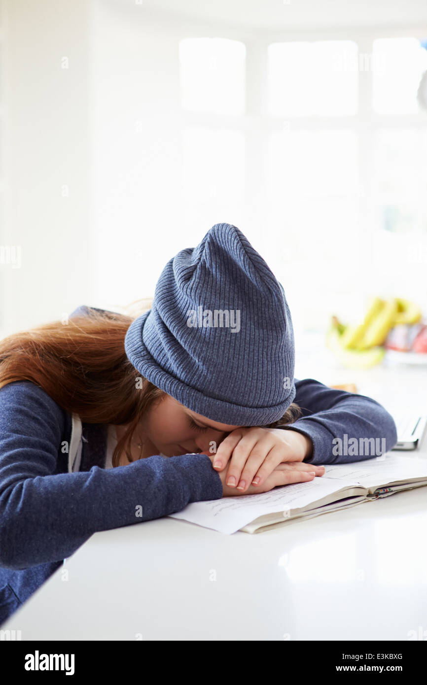 Depressed Girl Studying At Home - Stock Image