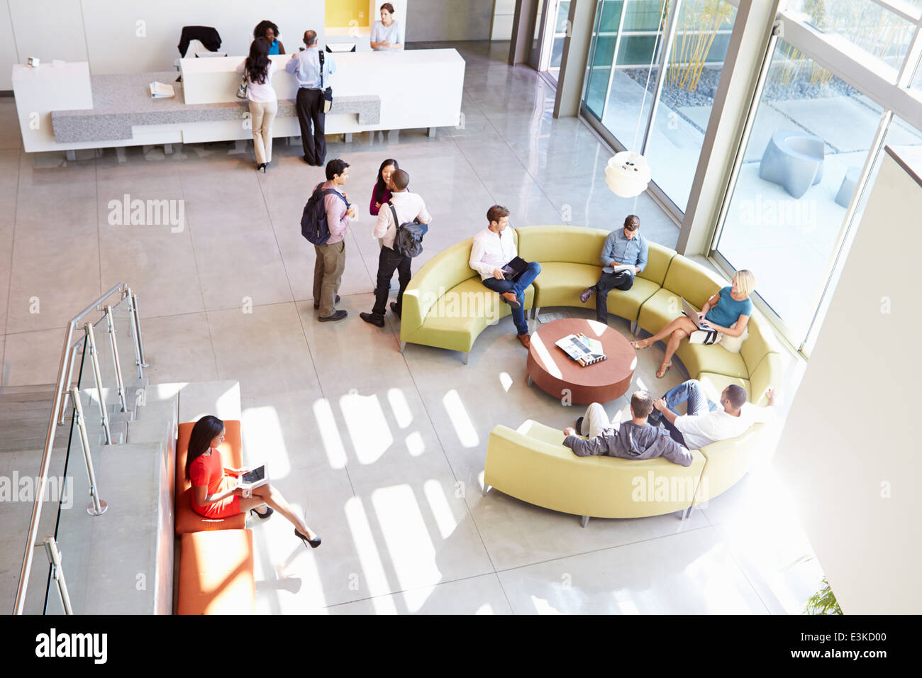 Reception Area Of Modern Office Building With People - Stock Image