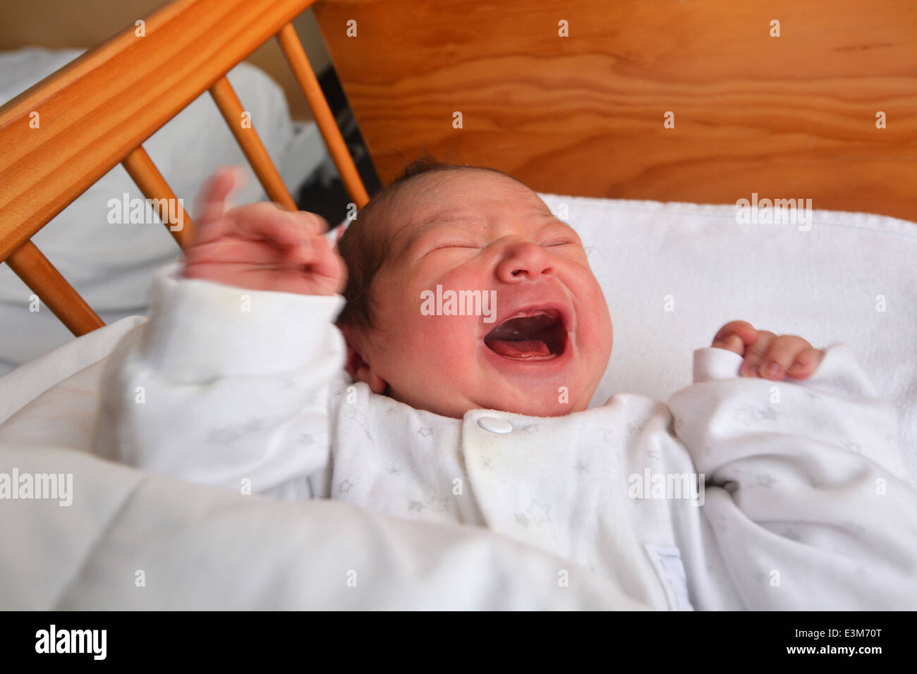 Newborn baby 1 day old screaming in baby cot bed