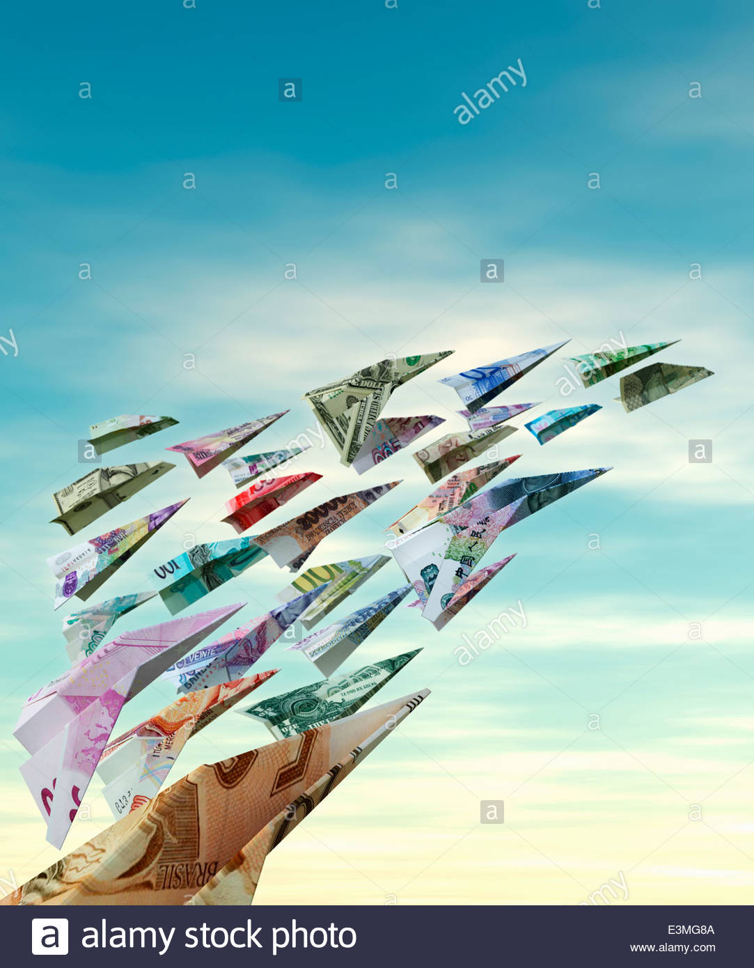 International currency flying as money paper airplanes - Stock Image