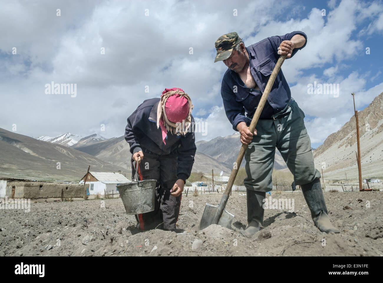 People planting potatoes in a remote village near the Pamir Highway, Tajikistan, Central Asia Stock Photo