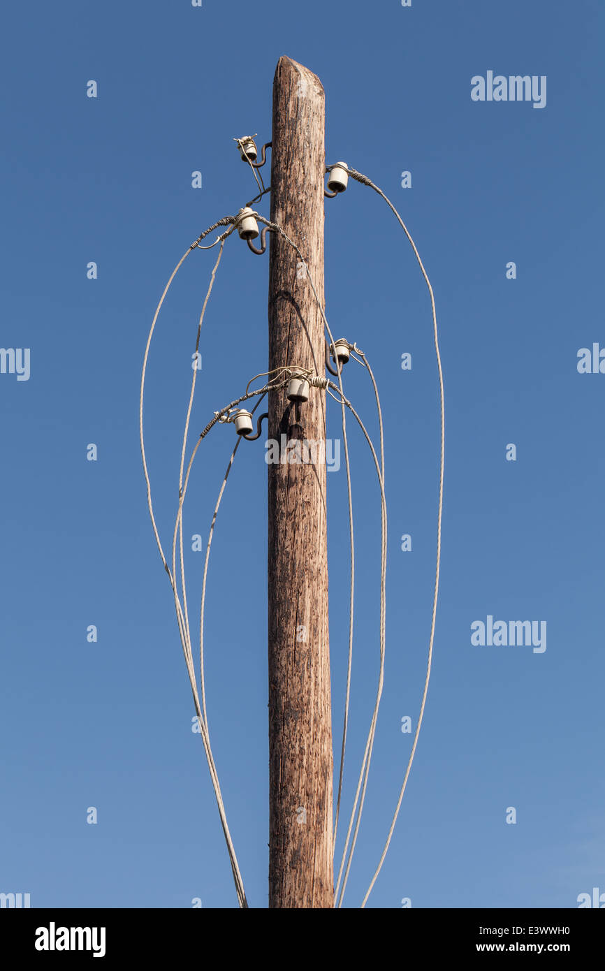 Disconnected electric wires on old wooden pylon Stock Photo ...