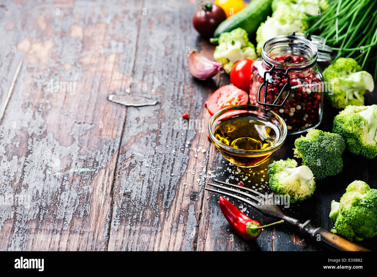 Fresh green broccoli and Healthy Organic Vegetables on a Wooden Background. - Stock Image