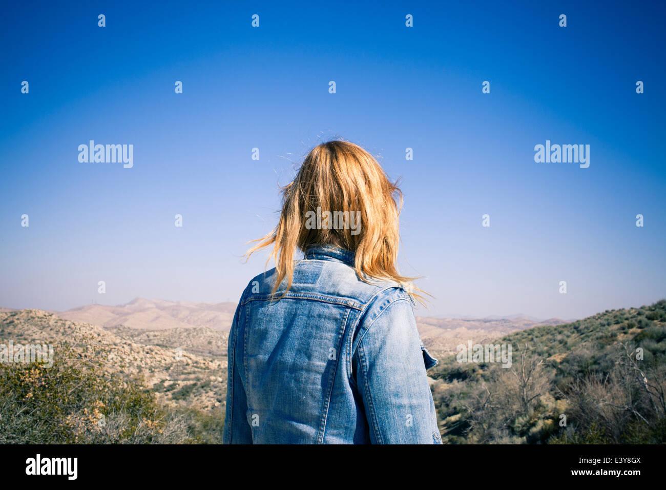 Rear view of mid adult woman gazing at view, Lake Arrowhead, California, USA Stock Photo