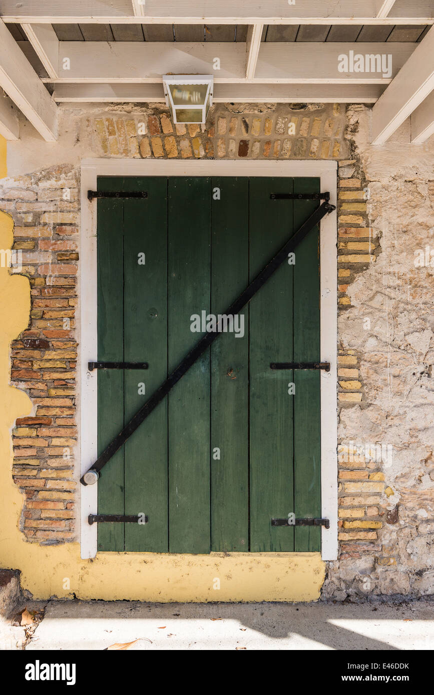 a-colorful-green-wooden-door-inset-into-