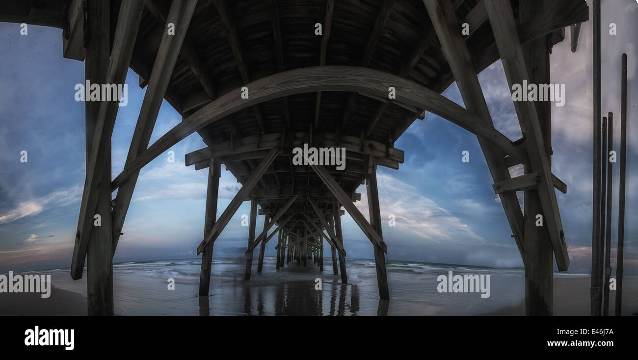 A dramatic late afternoon,panoramic image of The Jolly Roger Pier at Topsail Beach North Carolina. - Stock Image