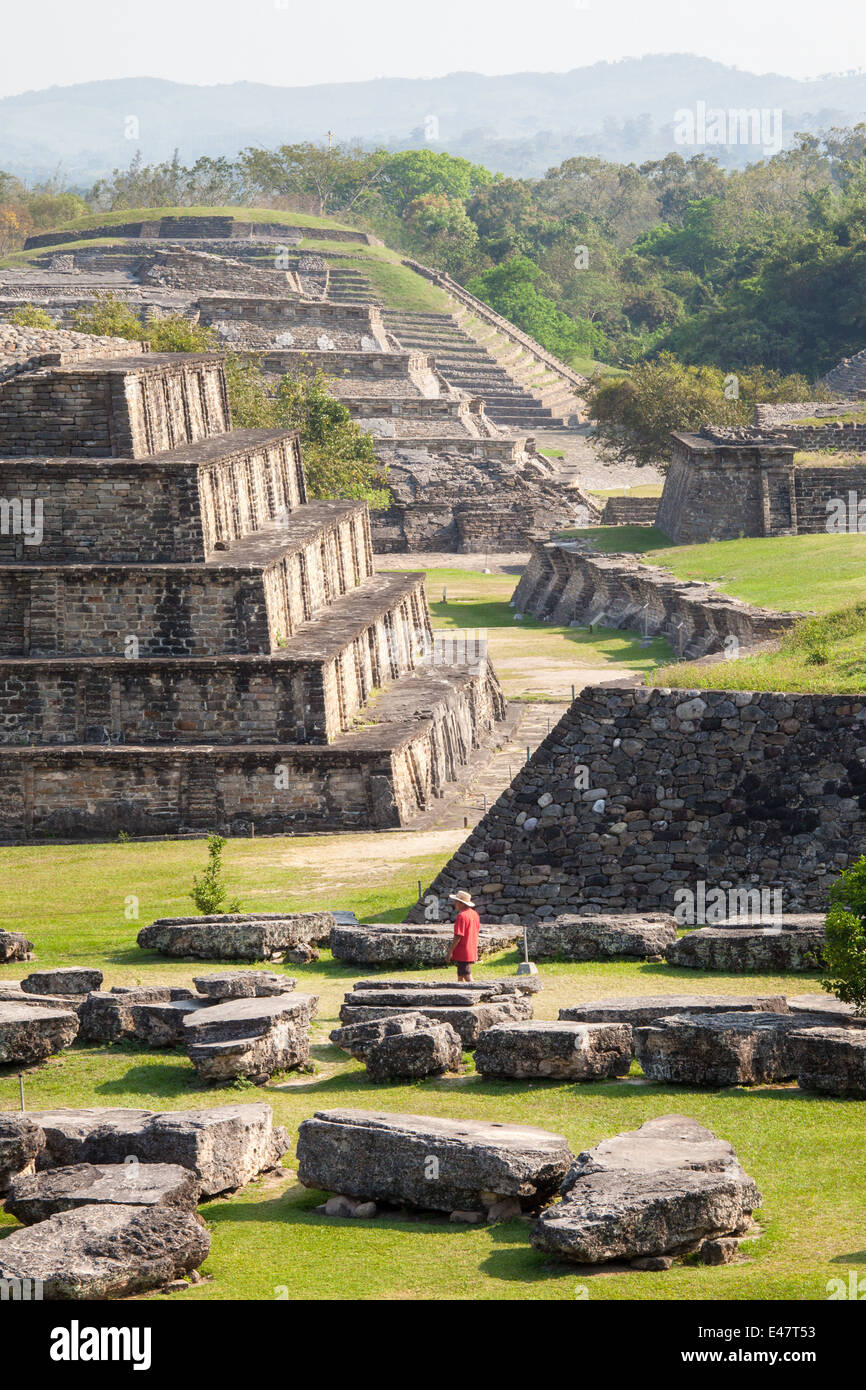 Tourist surveys the central plaza at the Tajin ruins in Veracruz, Mexico. - Stock Image