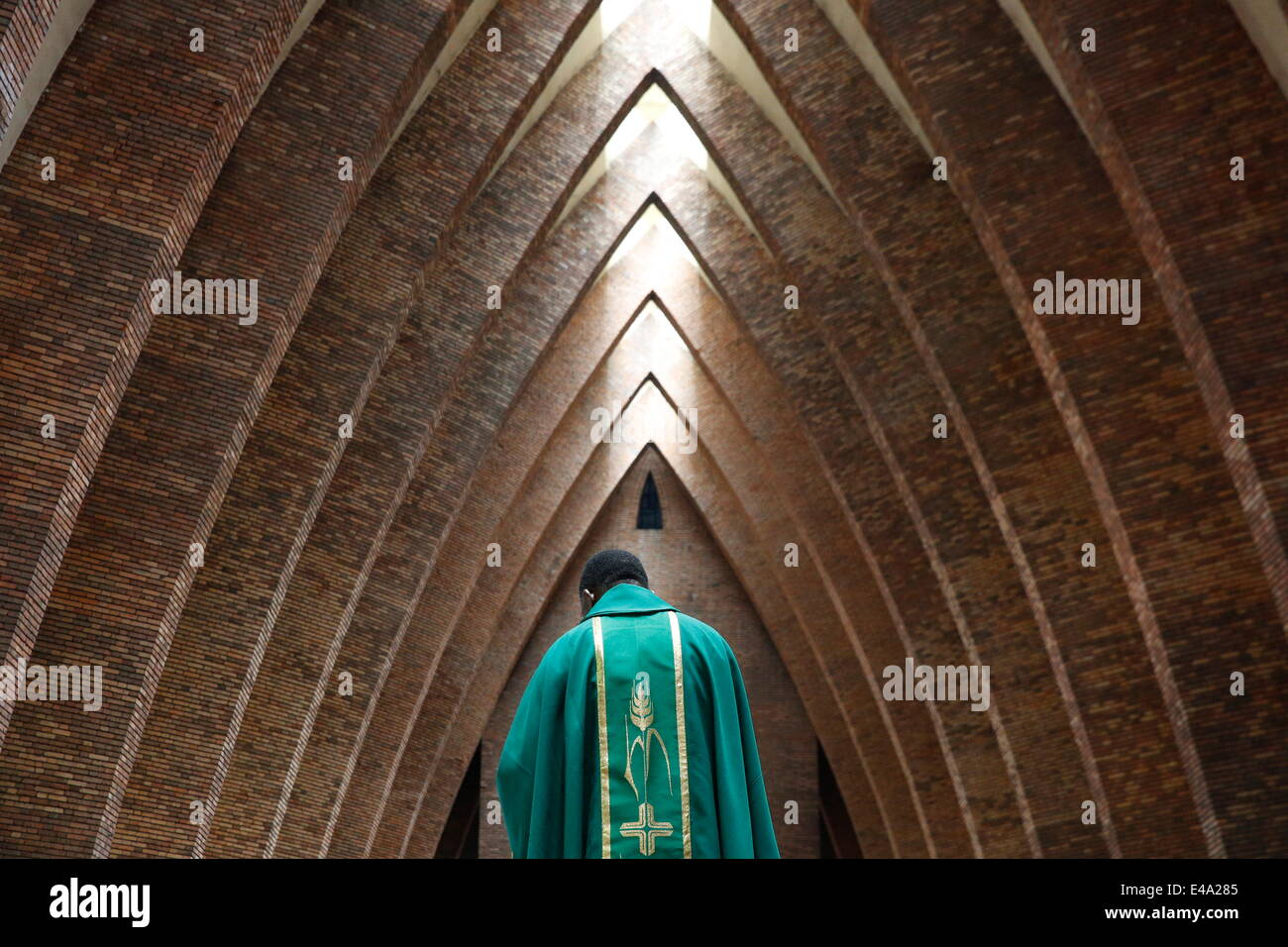 Priest during Catholic Mass, St. Anne's Basilica, Brazzaville, Congo, Africa - Stock Image