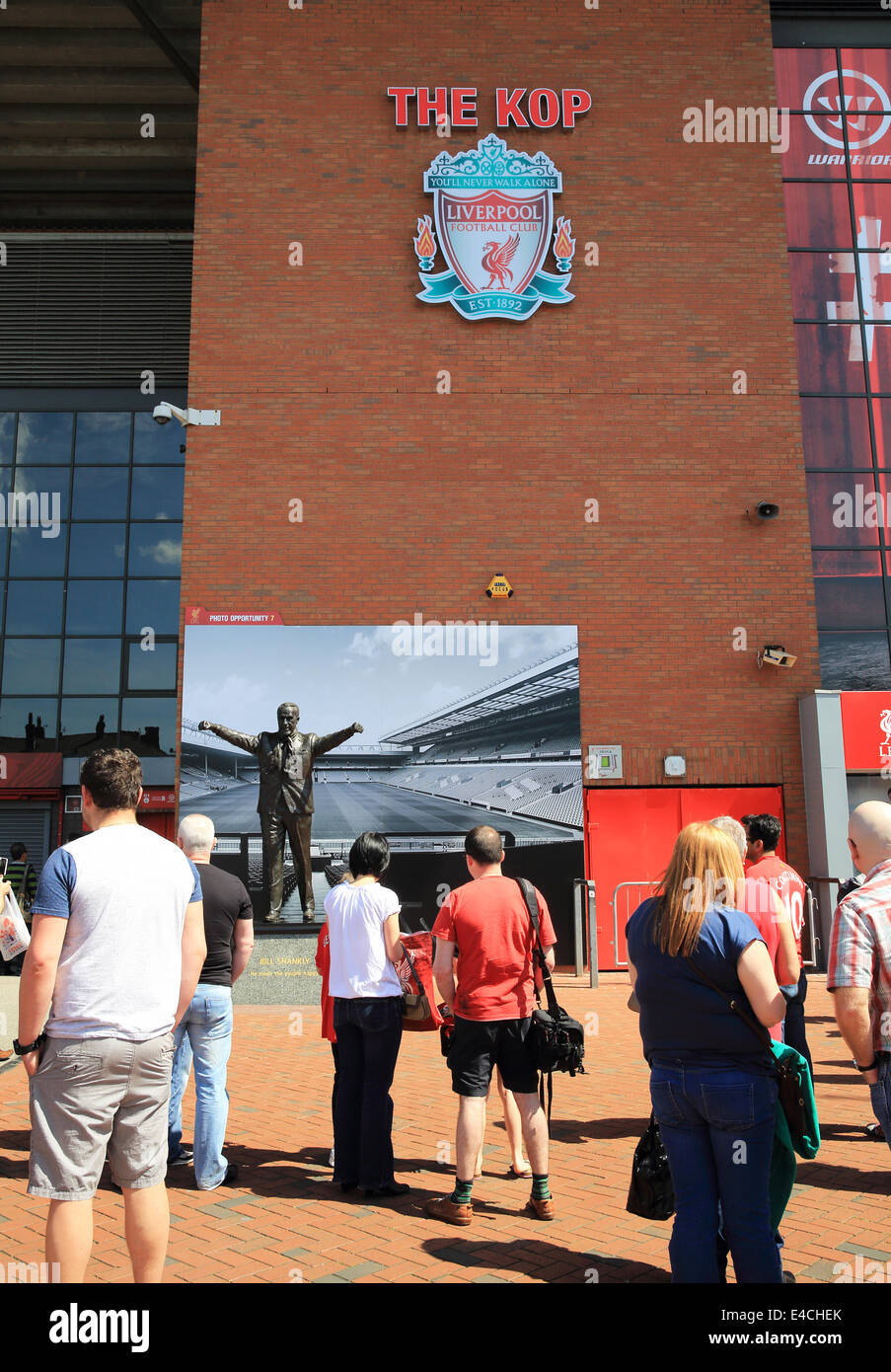 The Bill Shankly statue in front of the Kop, at Anfield, Liverpool Football Stadium, at the start of the stadium - Stock Image