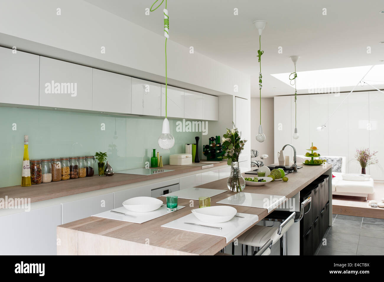Modern kitchen from beeck kuechen the green corded pendant lights the green corded pendant lights are by nud and the barstools by dwell aloadofball Images