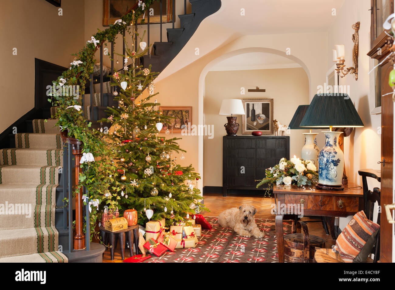 Christmas tree in entrance hall with early 20th century kilim the christmas tree in entrance hall with early 20th century kilim the hall table is french chestnut and the table lamps are antique aloadofball
