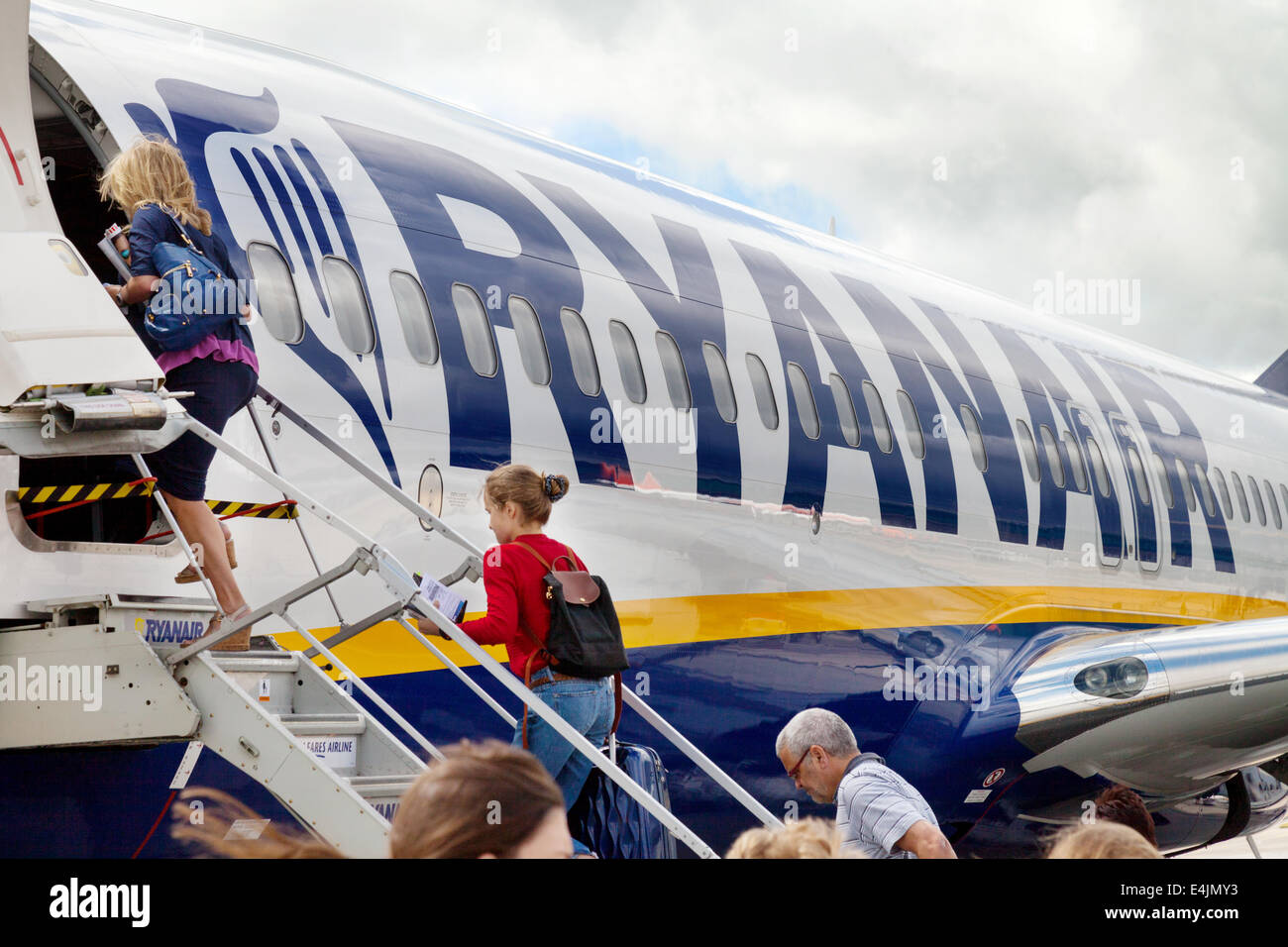 Passengers boarding a Ryanair plane at Stansted airport, London UK Stock Photo