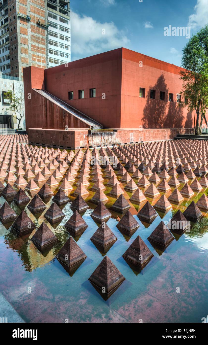 Plaza Juarez, Mexico City, Mexico. A set of 1034 reddish pyramids in a broad pool in Plaza Juarez. - Stock Image
