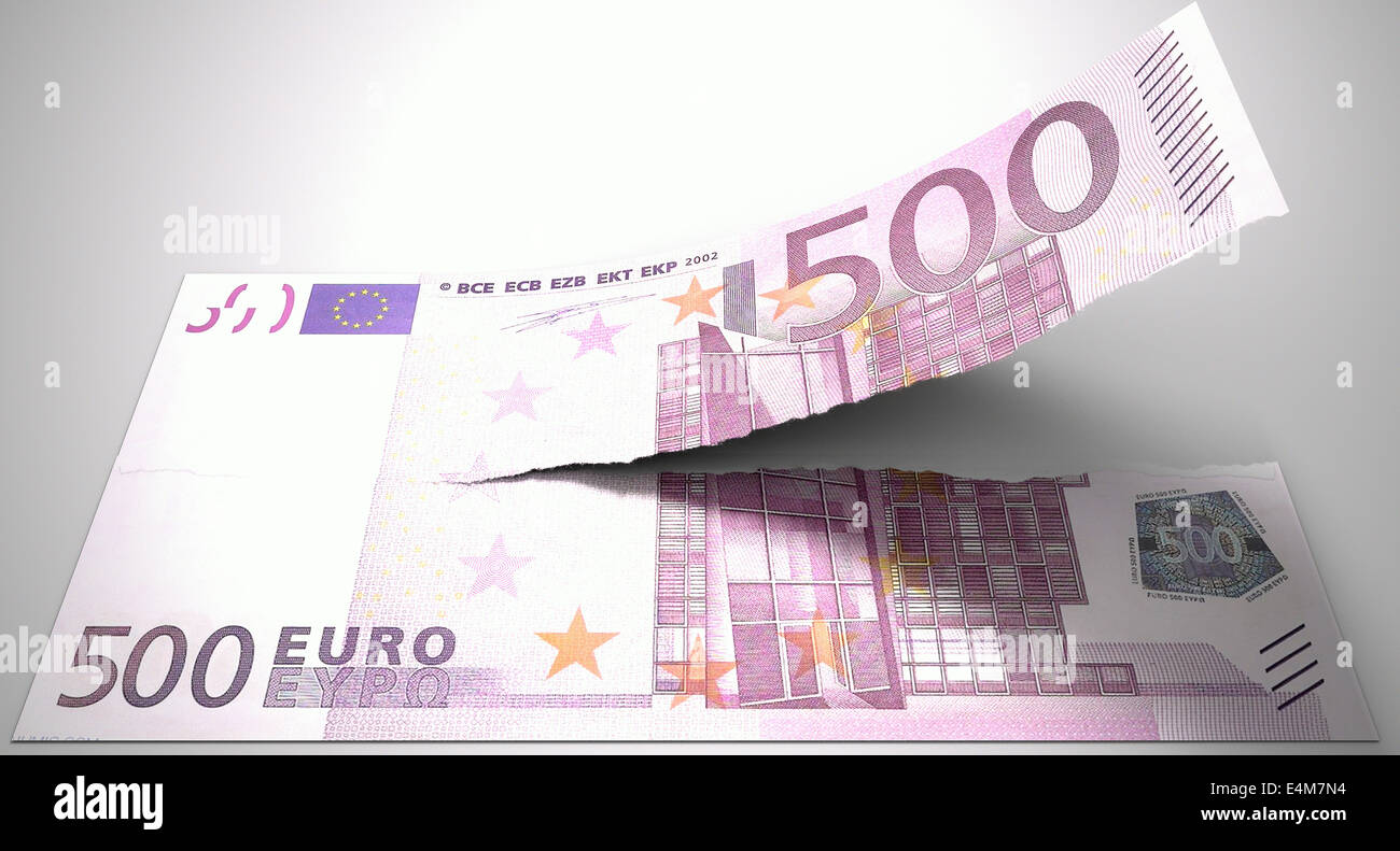 A concept picture of a regular american five hundred euro note tearing in two length ways on an isolated background Stock Photo