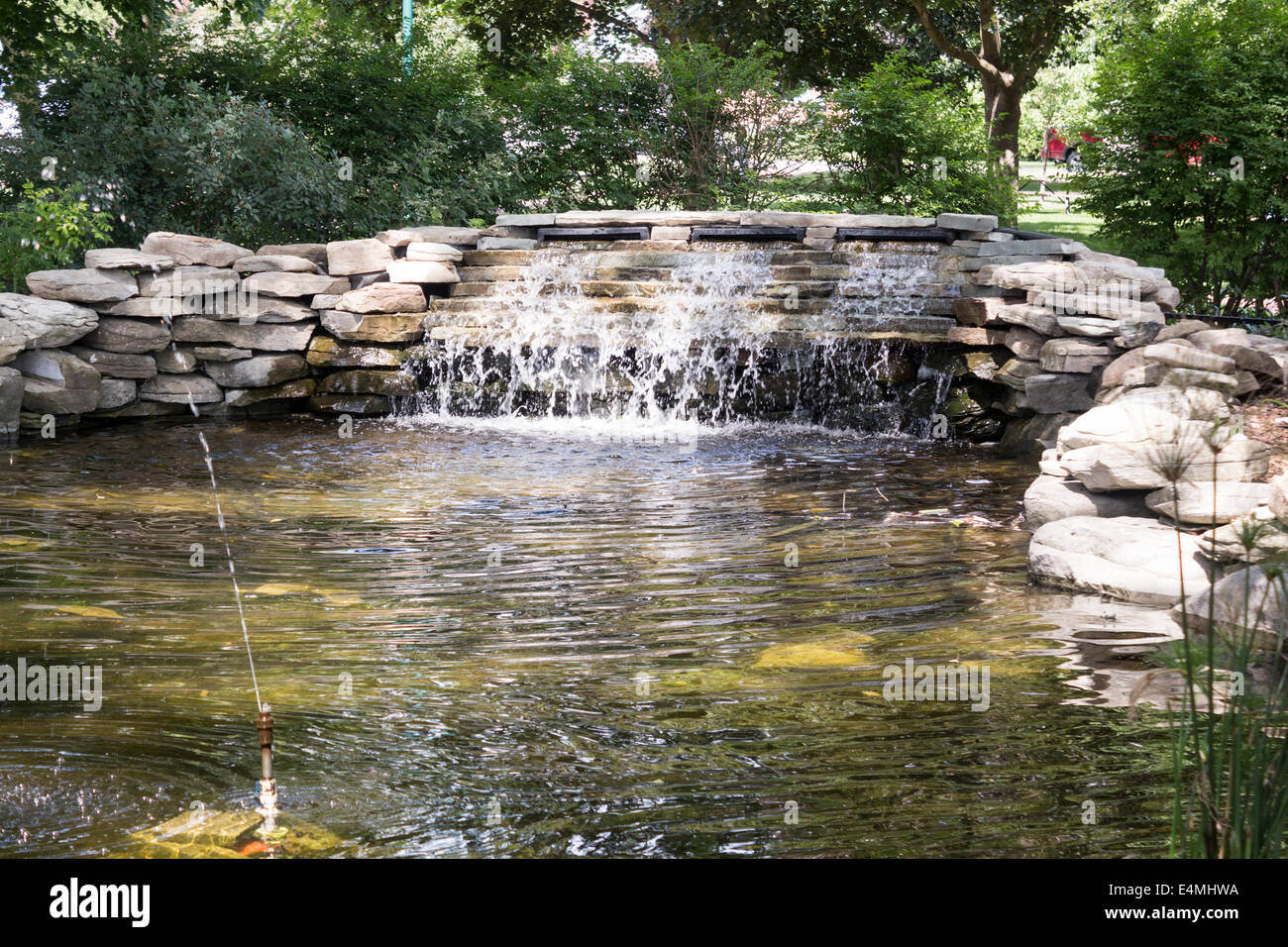 man-made-small-waterfall-surrounded-by-rocks-with-sprinkler-in-victoria-E4MHWA.jpg