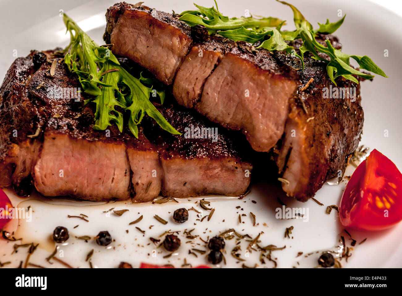 Pork neck steak with vegetables and pepper - Stock Image
