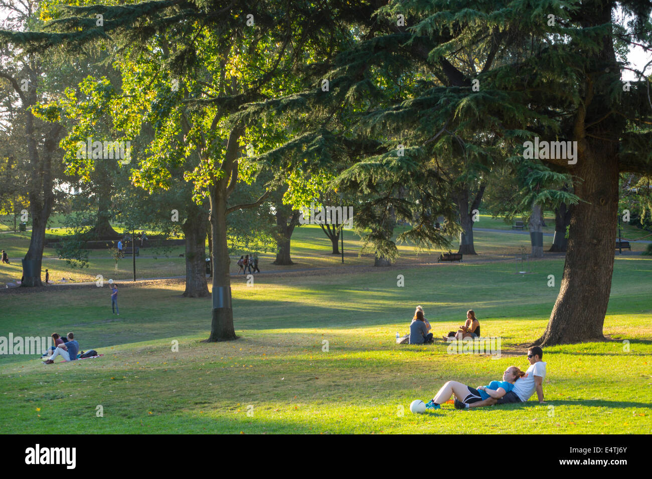 Australia, Victoria, West Melbourne, Flagstaff Gardens, public park, lawn, grass, trees, residents, relaxing, sightseeing Stock Photo