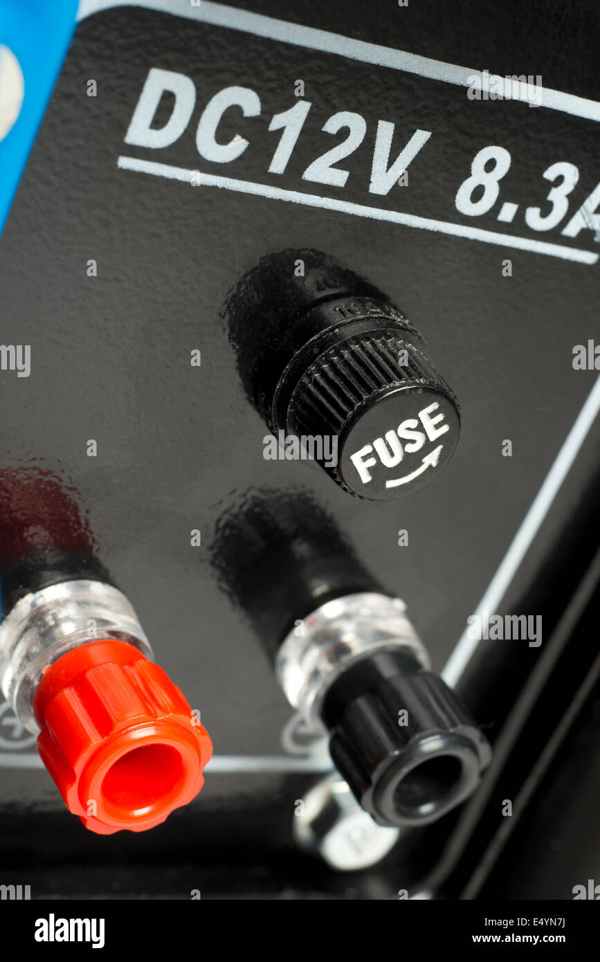 12 volt charging terminals and fuse, on a petrol driven, electricity generator. - Stock Image