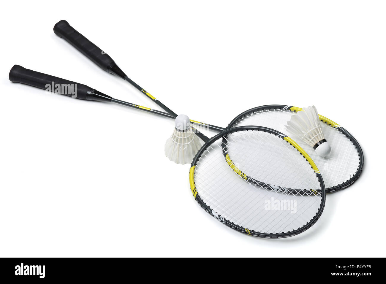 Badminton rackets and shuttlecocks isolated on white - Stock Image