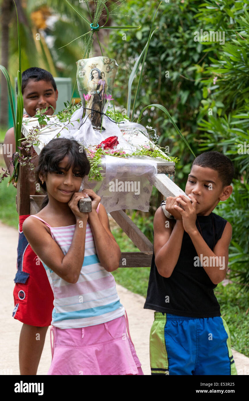 children-carrying-a-small-holy-week-proc