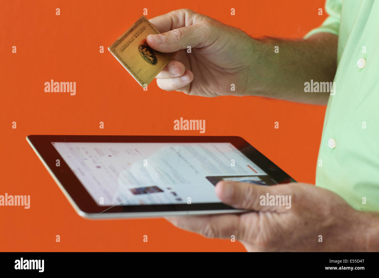 consumer with credit card - Stock Image