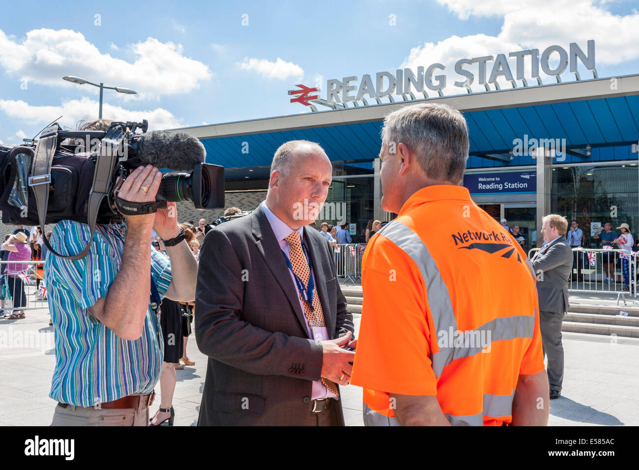 Journalist and Cameraman interview staff member of Network Rail at the official opening of Reading Station by HM Stock Photo