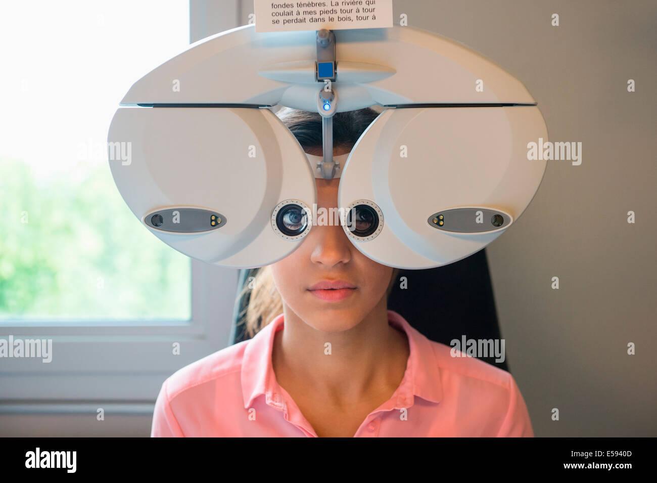 Female patient having eye examination - Stock Image