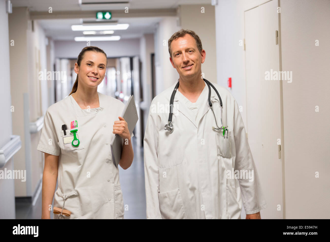 Doctor and female nurse smiling - Stock Image