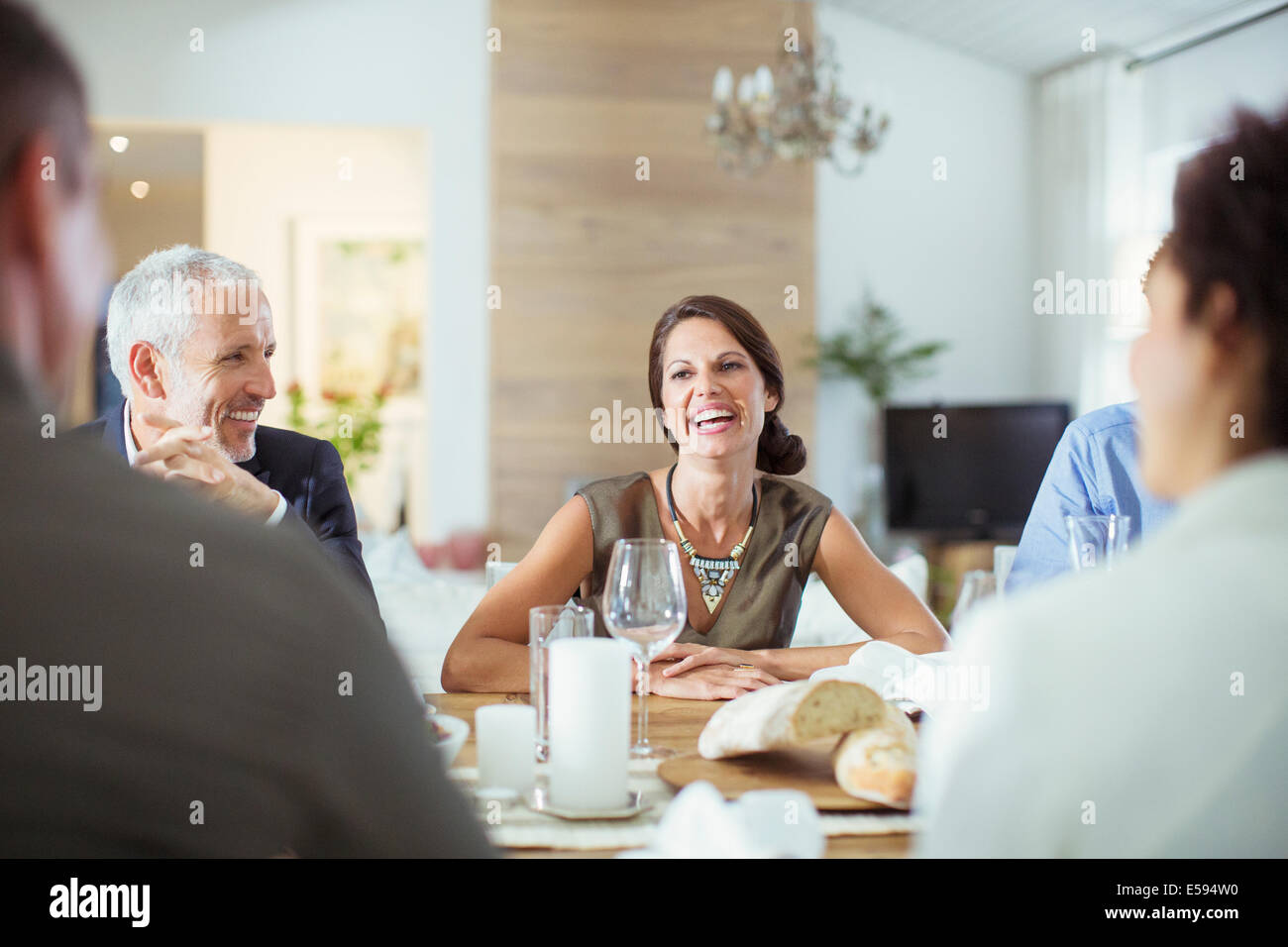 People talking at dinner party - Stock Image