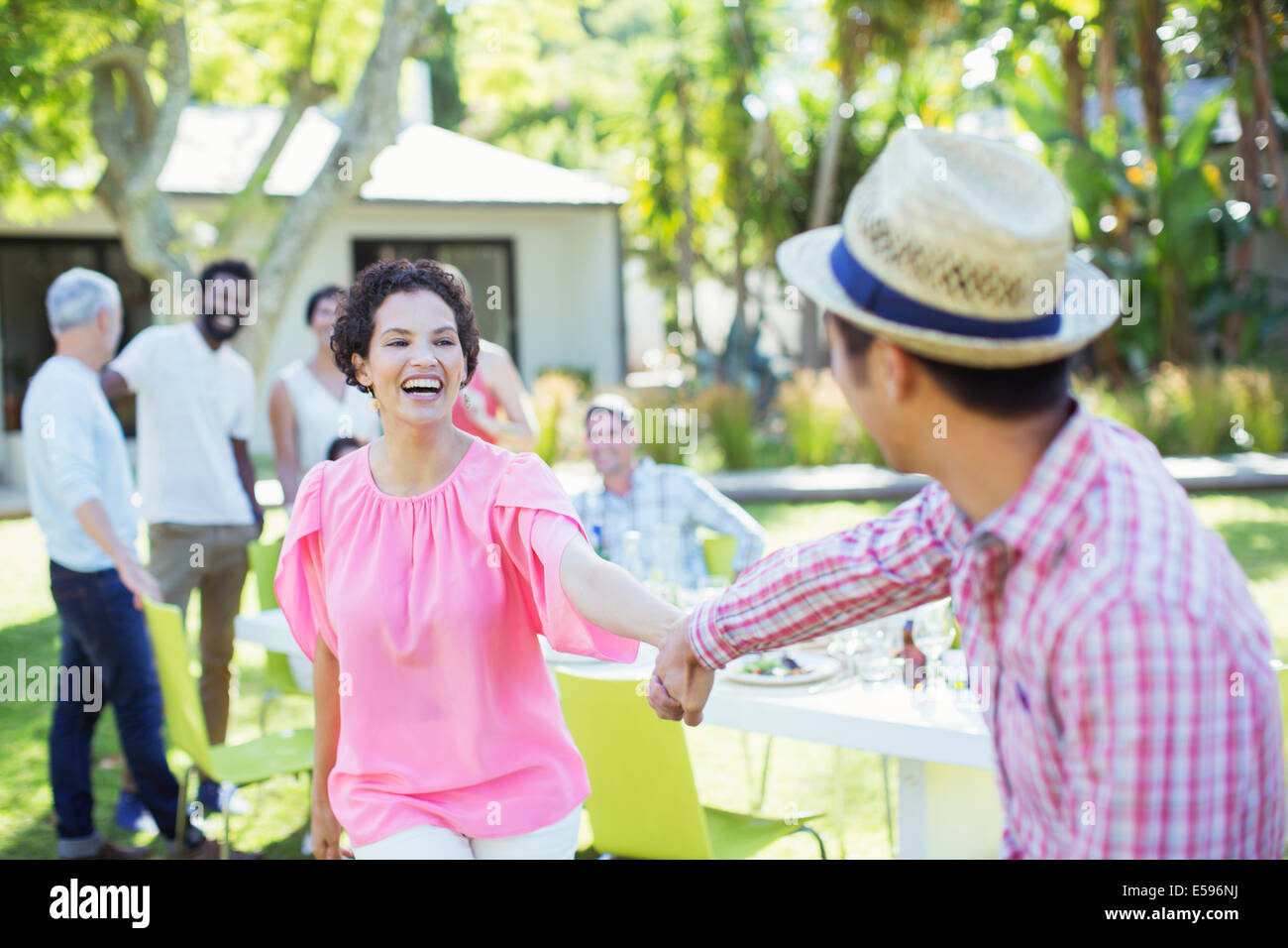 Couple dancing at party - Stock Image