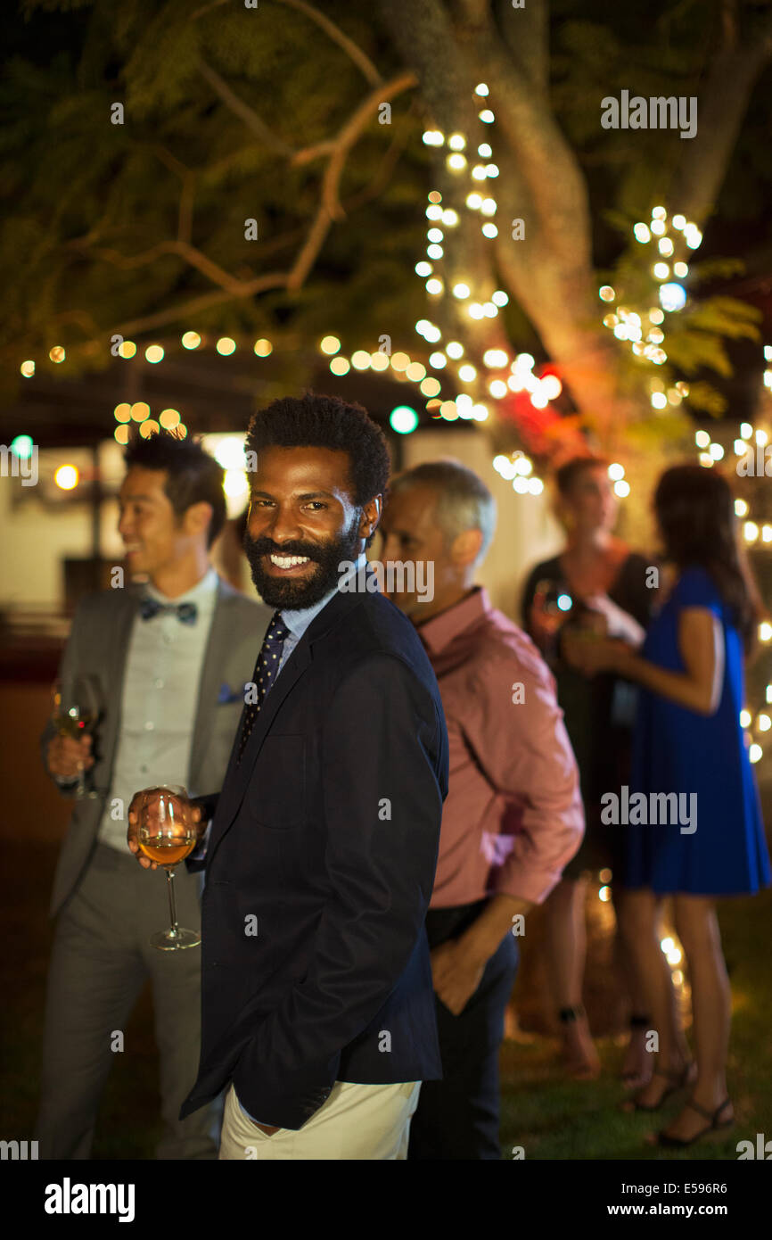 Man laughing at party - Stock Image