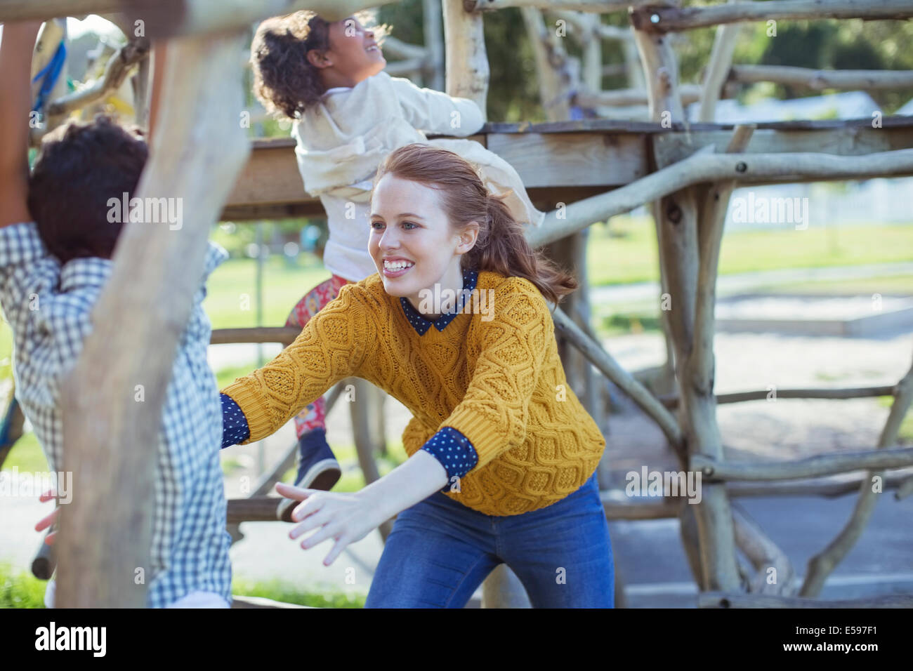 Student and teacher playing outdoors - Stock Image