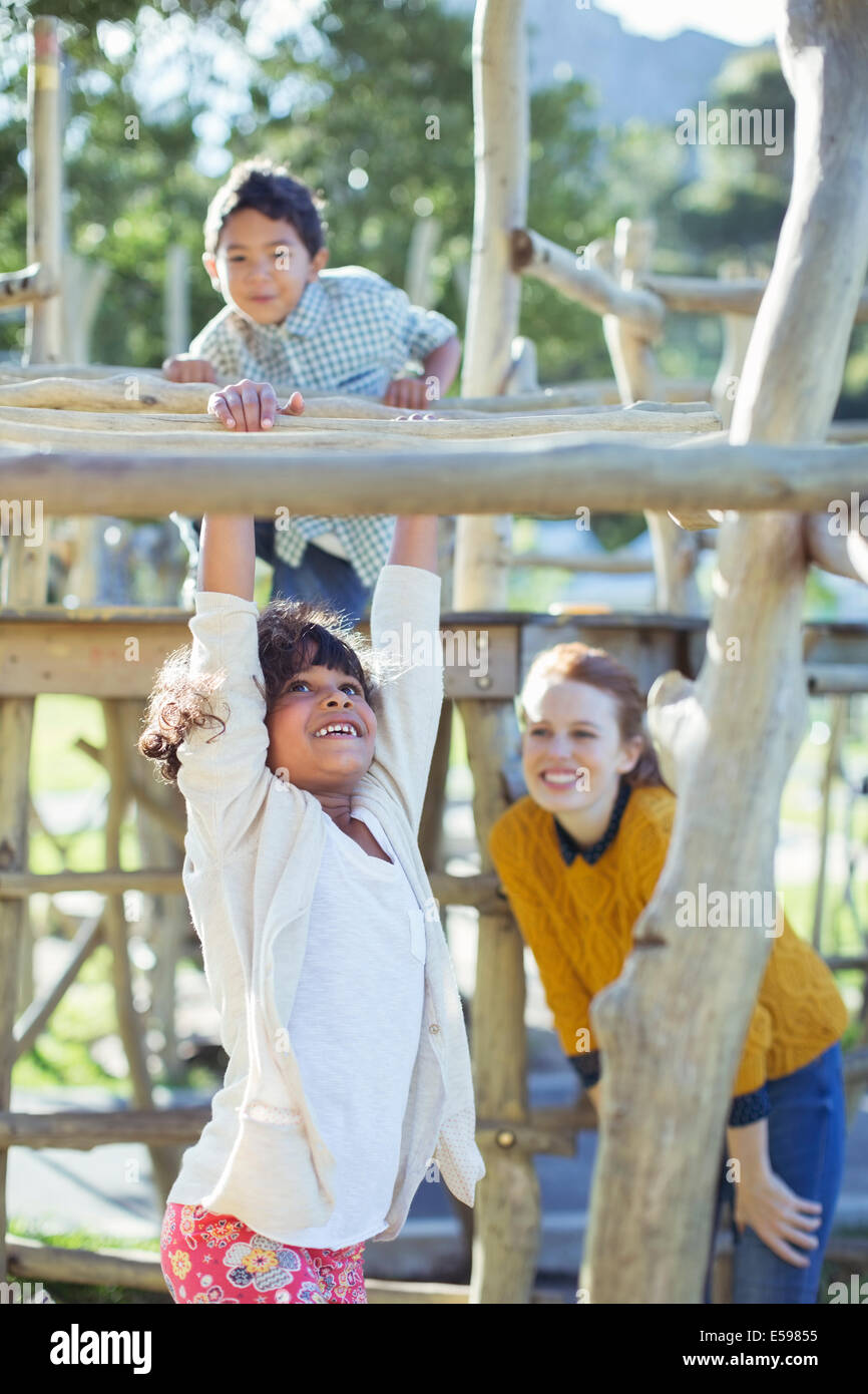 Teachers and students playing on play structure - Stock Image