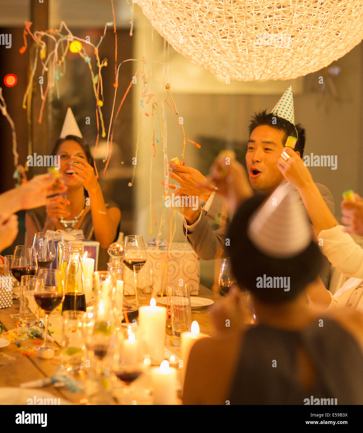 Friends celebrating at party - Stock Image