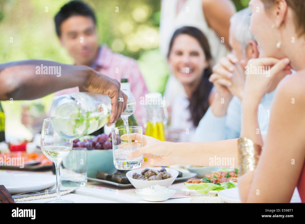 Friends eating together outdoors - Stock Image