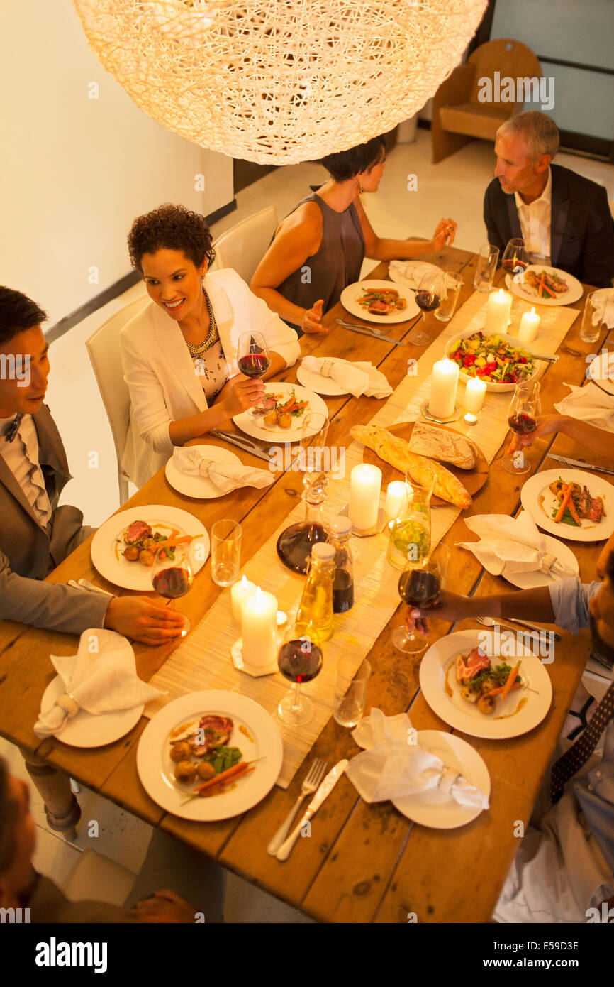 Friends eating together at dinner party - Stock Image