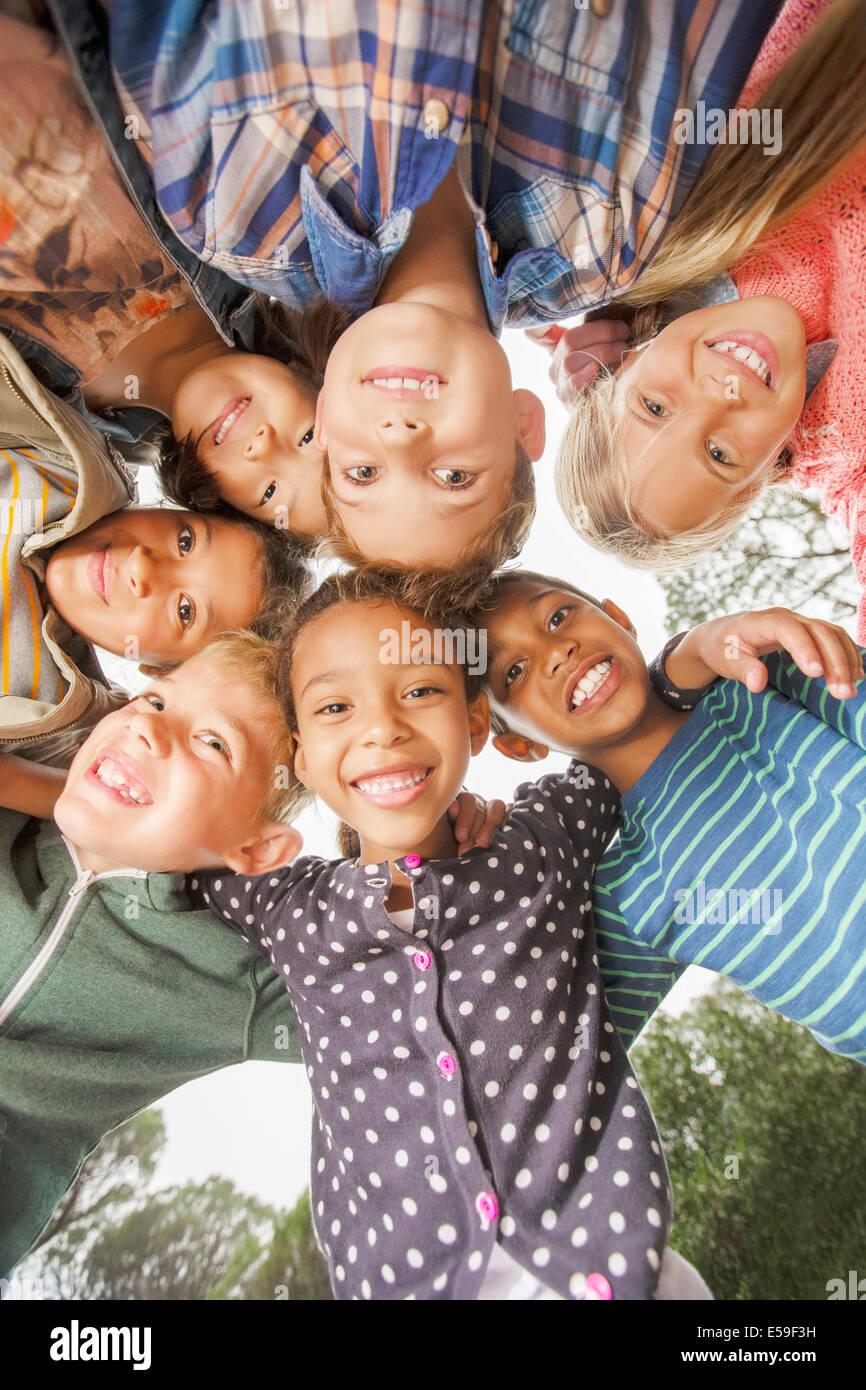 Children huddled together outdoors - Stock Image