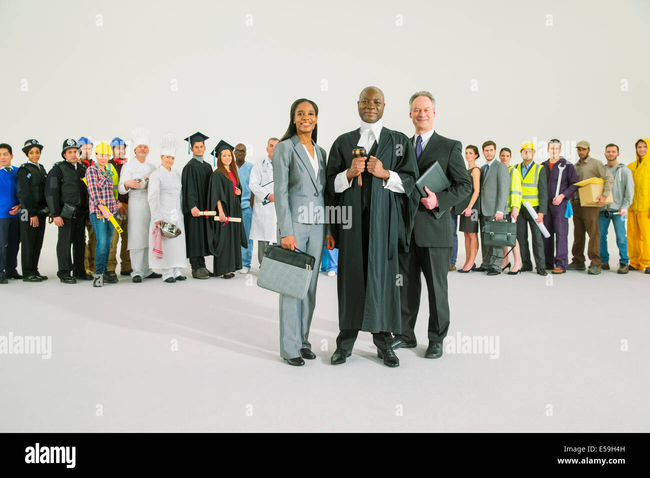 Workforce behind confident judge and lawyers - Stock Image